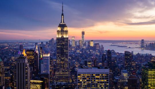 the New York City skyline at sunset