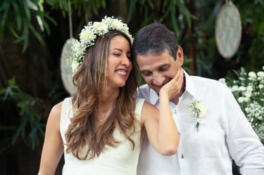 a bride and groom smile on their wedding day